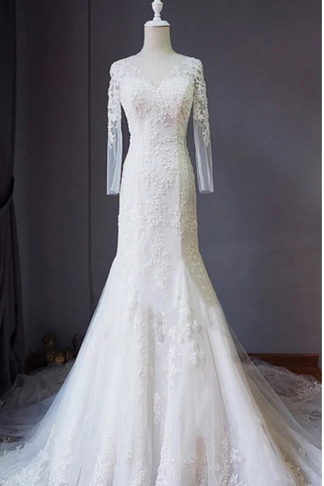 Long Sleeve Mermaid Wedding Dress Featuring Lace Appliqués and Lace-Up Back